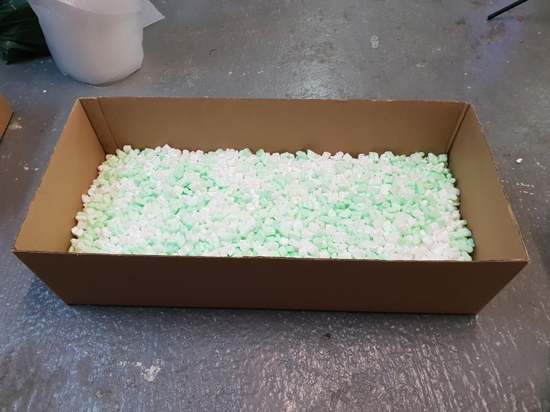 File:Packing box 1 3 full foam chips.jpg